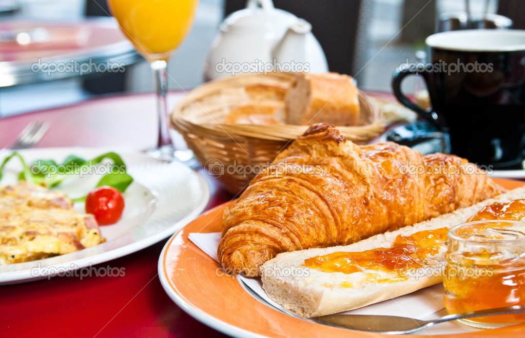 Breakfast with coffee and croissants on table  Stock Photo #6573094