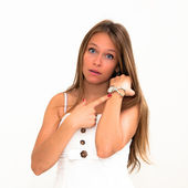 Checking the time on her wrist watch — Stock Photo