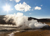 Steam at high pressure of the Sulphurous hill Namafjall in Iceland. Blue sk — Stock Photo