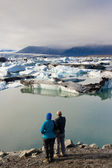Couple in love. In background Jokulsarlon lagoon - Iceland. — Stock Photo