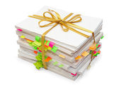 Pack of documents tied up by a gold ribbon — Stock Photo