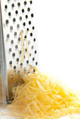 Freshly grated cheese — Stock Photo