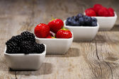 Bowls with wild berries — Stock Photo