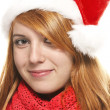 Smiling redhead young woman with santas hat — Stock Photo