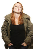 Happy young redhead woman in parka — Stock Photo