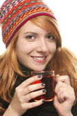 Young smiling woman with winter cap warming-up with tea — Stock Photo