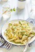 Rice with chicken and green beans on blue table — Stock Photo