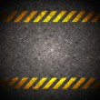 Metal background with caution tape — Stock Photo
