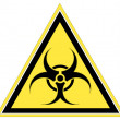 Stock Photo: Biohazard warning on yellow triangle sign