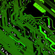 Electronic circuit board in green &amp; black - texture - Stock Photo