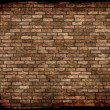 Old weathered stained red brick wall background — Foto Stock