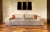 Modern sofa in a white living room-rendering- the art pictures — Stock Photo
