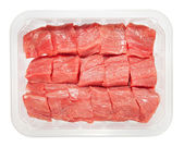 The pieces of raw meat in box isolated on white background — Stock Photo