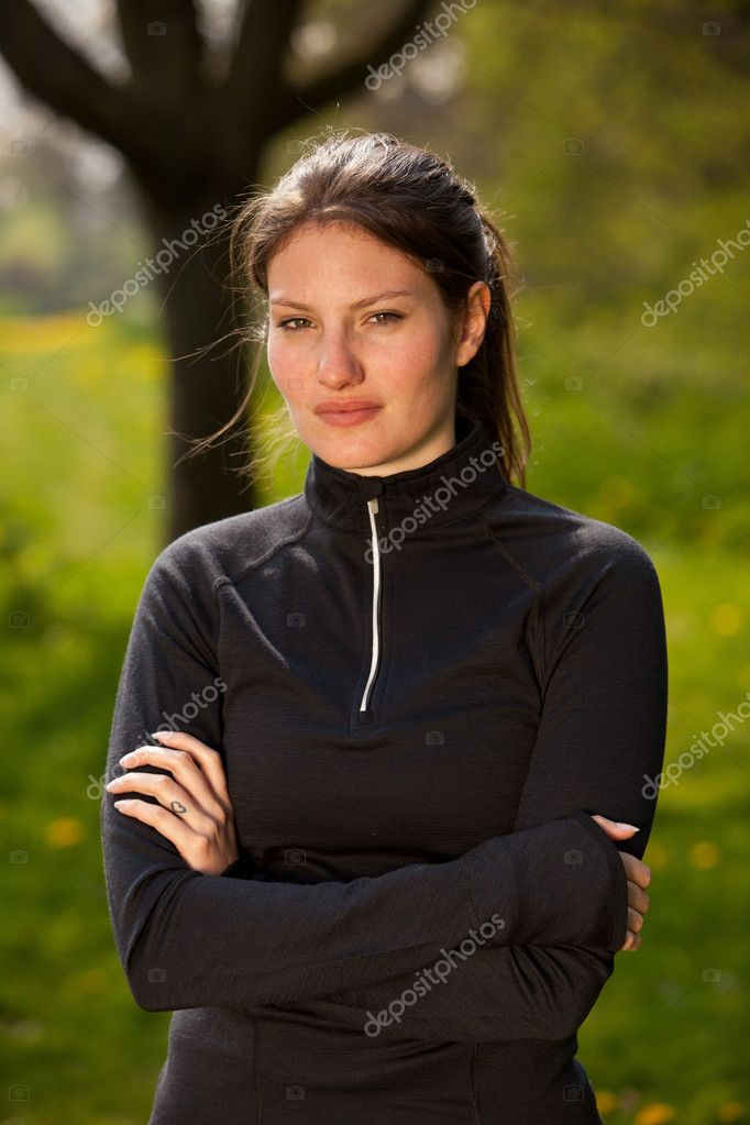 Sporty girl in sportswear standing outside  Stock Photo #5536647