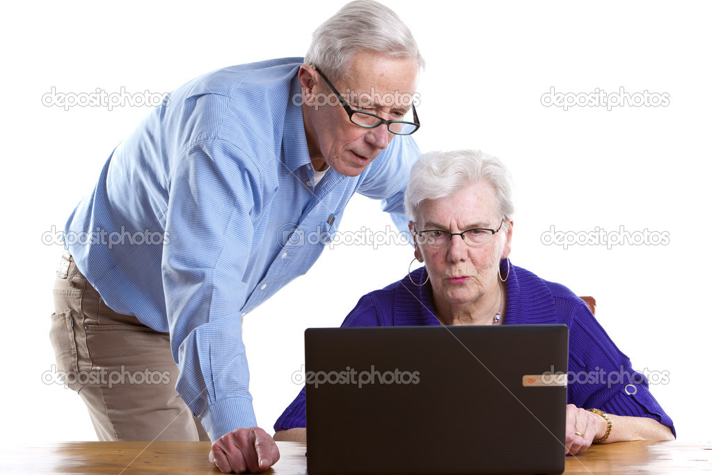 Senior man and woman behind the laptop checking things out — Stock Photo #5536658