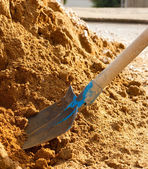 Spade and sand — Stock Photo