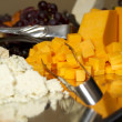 Close up of cubed cheddar cheese — Stock Photo