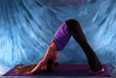 Woman in down dog yoga pose — Stock Photo