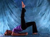 Woman in One Leg Bridge yoga pose — Stock Photo