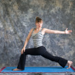 Stock Photo: Womdoing Yogposture rotated high lunge