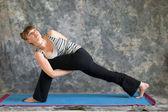 Woman doing Yoga posture Parsvakonasana or bound Extended Side A — Stock Photo