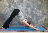 Young woman doing Yoga posture Adho Mukha Svanasana or Downward — Stock Photo