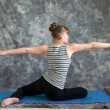 Woman doing Yoga posture Virabhadrasana II or seated warrior 2 p — Stock Photo