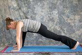 Woman doing Yoga posture lunge pose — Stock Photo