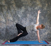 Young woman doing Yoga posture Vasisthasana or side plank pose v — Stock Photo