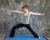 Woman doing Yoga posture Virabhadrasana II or warrior 2 pose — Stock Photo