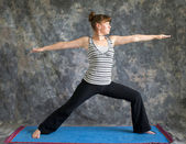 Young woman doing Yoga posture Virabhadrasana II or warrior 2 po — Stock Photo