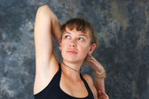 Woman doing yoga exercise Kapotasana or King Pigeon Pose agains — Stock Photo