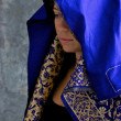 Mystical woman in blue and gold cape with hood — Foto de Stock