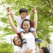 Happy Asian Mother with her daughter and son — Stockfoto