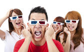 Surprised Young in 3D glasses and watching a movie — Stock Photo