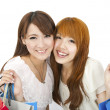 Happy young girls standing together with shopping bags — Stock Photo #5590880