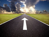 The road to the sunrise and forward mark — Stock Photo