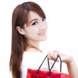 Beautiful asian woman holding shopping bag — Stock Photo #5617134