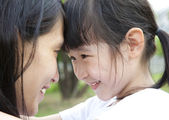Beautiful little girl looking her mother — Stock Photo