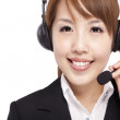 Smiling businesswoman and Customer Representative with headset — Stock Photo