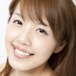 Smiling beautiful asian woman's face with fresh clean skin — Stock Photo