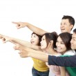 Happy Asian young group pointing away isolated on white background — Stock Photo