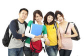 Four young happy students — Stock Photo