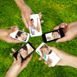 Social network on the smart phone of young group — Stock Photo