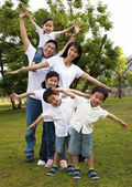 Happy asian family in the park — Stock Photo