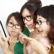 Three Students with touch screen tablet computer — Stock Photo