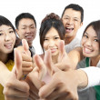 Young asian Group with thumbs up - Stock Photo