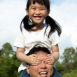 Happy family at park. girl and her father — Stock Photo