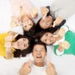 Stock Photo: Group of asian young lying together with thumb up