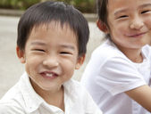 Smiling asian boy and girl — Stock Photo